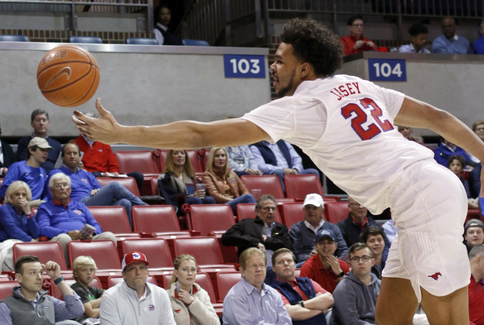 SMU forward Isiah Jasey (22) lunges to keep an errant pass alive during first half action against Memphis. SMU won 58-53. The two teams from the NCAA's American Athletic Conference played their men's basketball game at SMU's Moody Coliseum in Dallas on February 25, 2020.