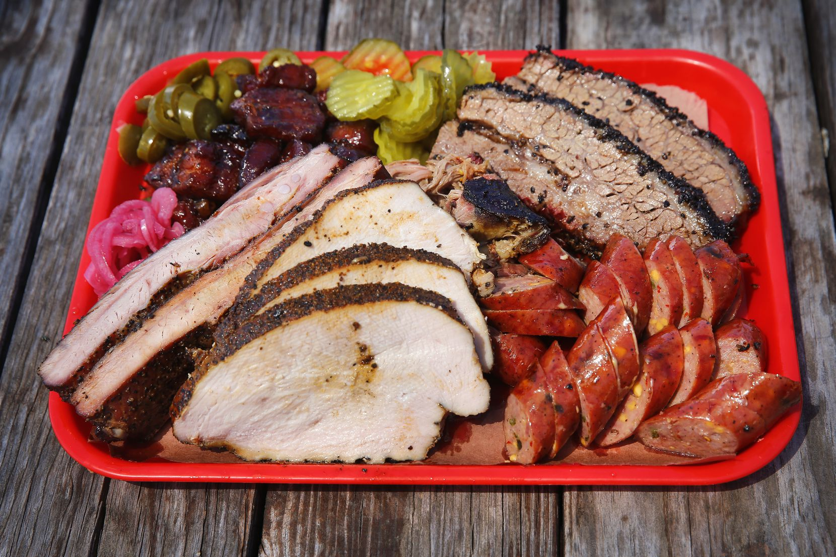 Panther City BBQ serves Hell's Half Acre, a tray full of brisket, pulled pork, sausage, pork ribs, smoked turkey and pork belly.