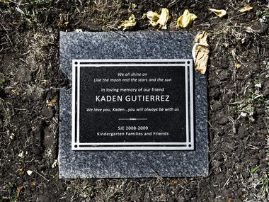 A plaque on the school grounds of Mockingbird Elementary in Dallas commemorates 16-year-old Kaden Gutierrez, who died by suicide on the first day of the current school year. Family friends dedicated a Chinese pistache tree and installed the plaque in Kaden's memory Feb. 21, which would have been his 17th birthday.