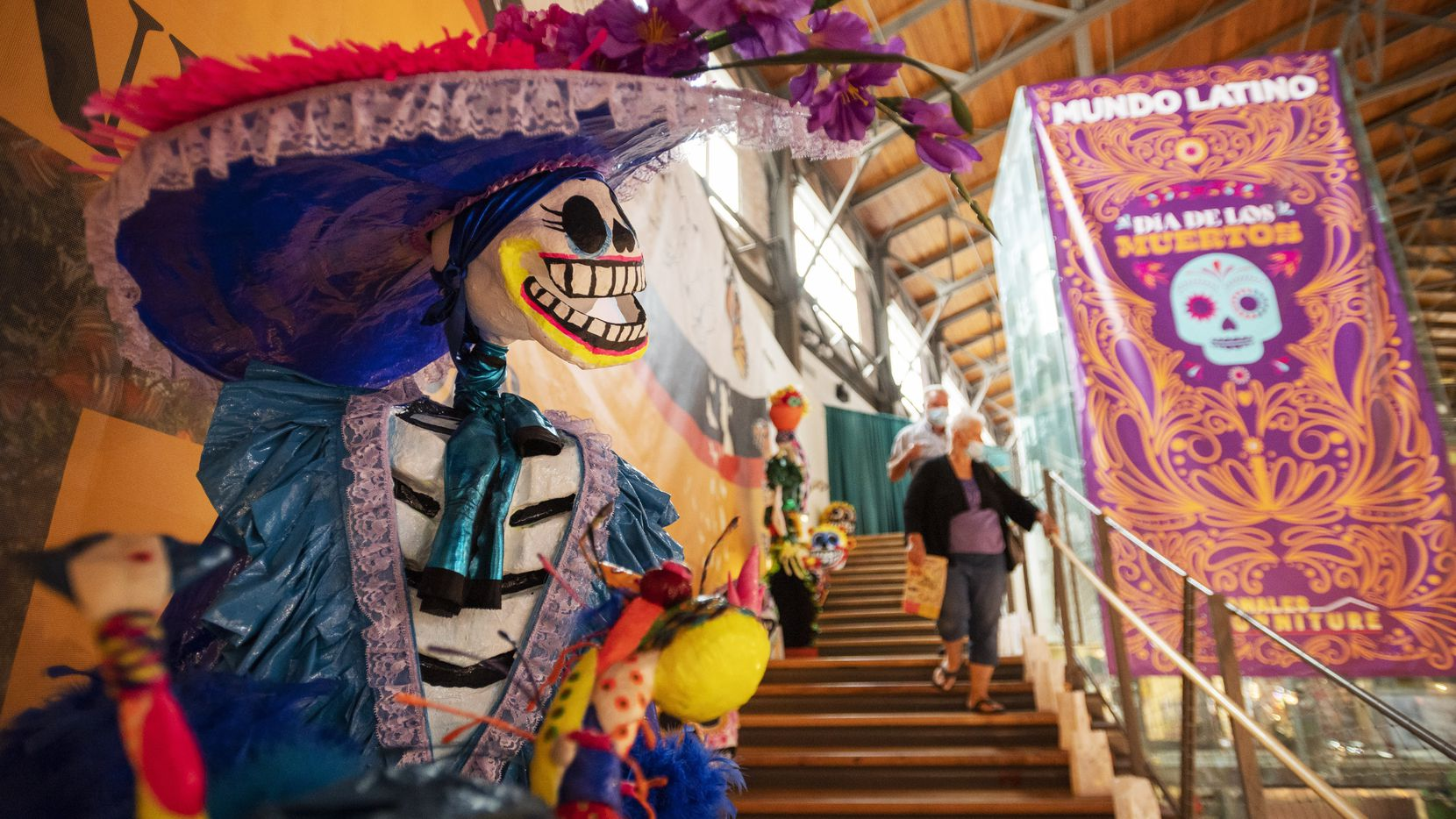 A large calavera decorates the stairwell that leads to the main exhibit hall celebrating Dia de los Muertos at the Mundo Latino exhibit inside the Women's Building at the State Fair of Texas, on Thursday, Sept. 30, 2021 in Dallas.