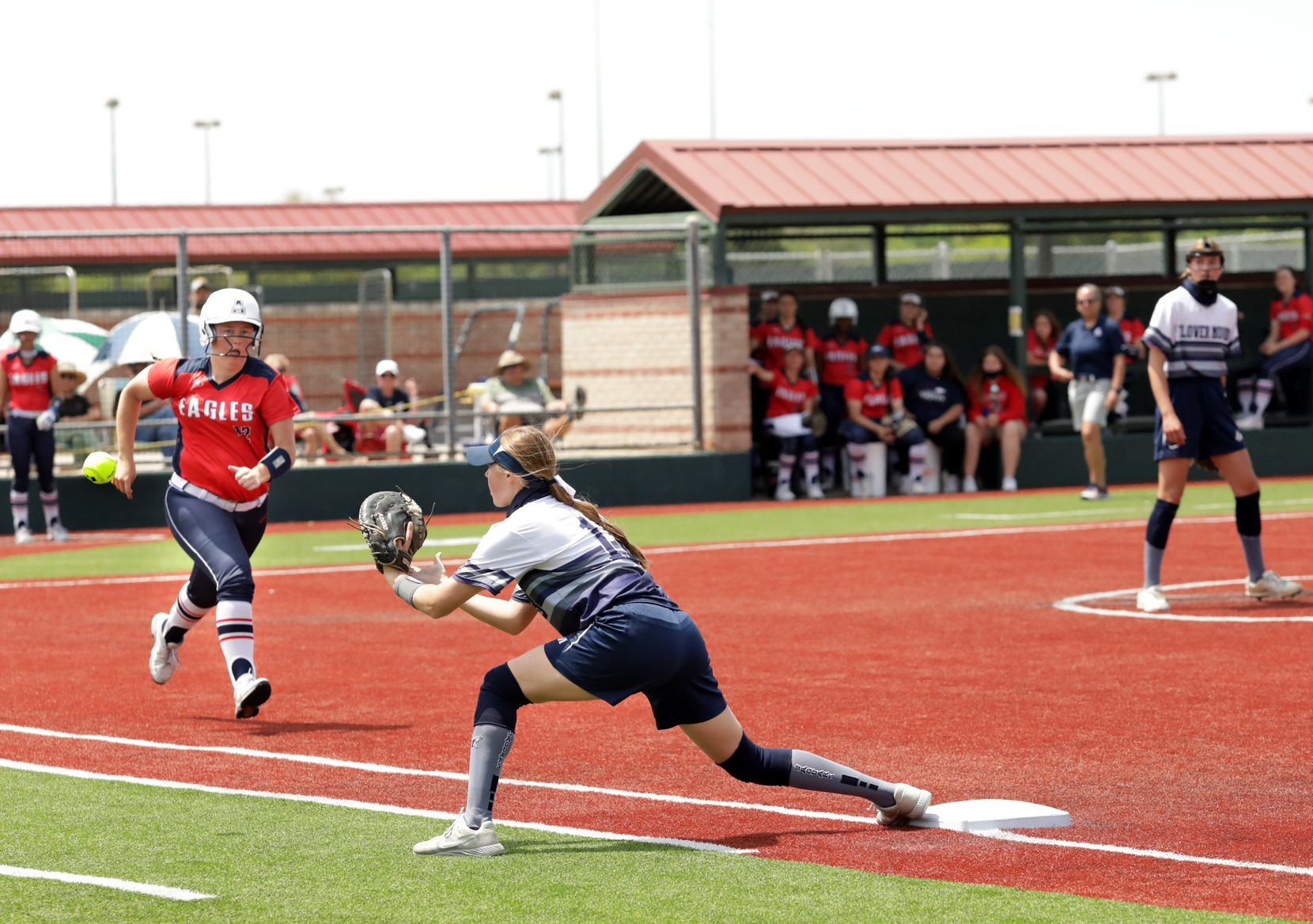 Allen High School player #12, Mackenzie Duckworth, is stopped by Flower Mound High School player #18, Jordyn Holland, during a softball playoff game at Allen High School in Allen, TX, on May 15, 2021. (Jason Janik/Special Contributor)