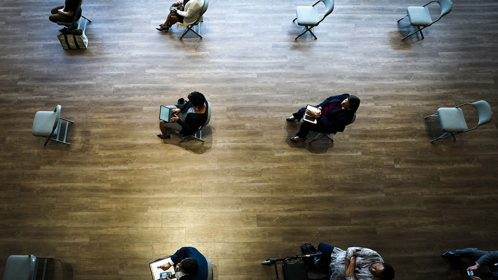 Chairs are spaced to ensure social distancing for city staff watching a video feed of a Dallas City Council meeting at City Hall on Wednesday, March 18, 2020, in Dallas. Council met in a special meeting to vote on whether to extend the mayor's state of disaster declaration.
