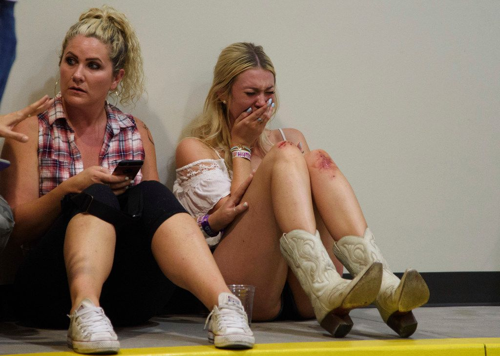 A woman cries while hiding inside the Sands Corp. plane hangar after Sunday's mass shooting in Las Vegas. (Al Powers/AP)