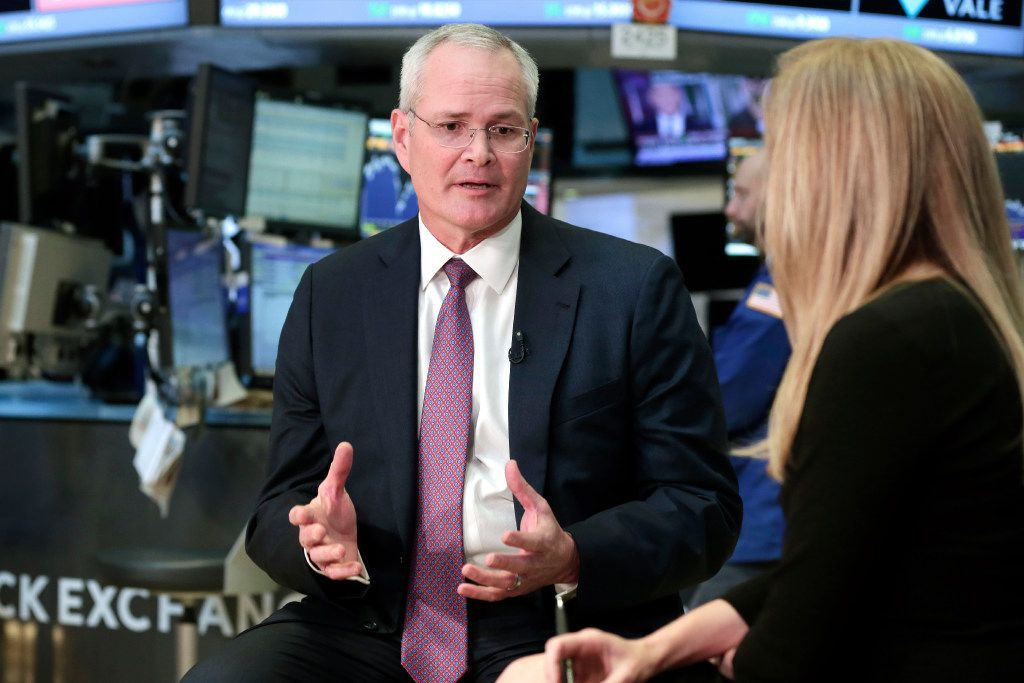 Exxon Mobil Chairman & CEO Darren Woods is interviewed on the floor of the New York Stock Exchange, Wednesday, March 1, 2017. The new CEO of Exxon Mobil says the company will increase production and has a mix of projects that will let Exxon respond to any level of oil and gas prices. (AP Photo/Richard Drew)