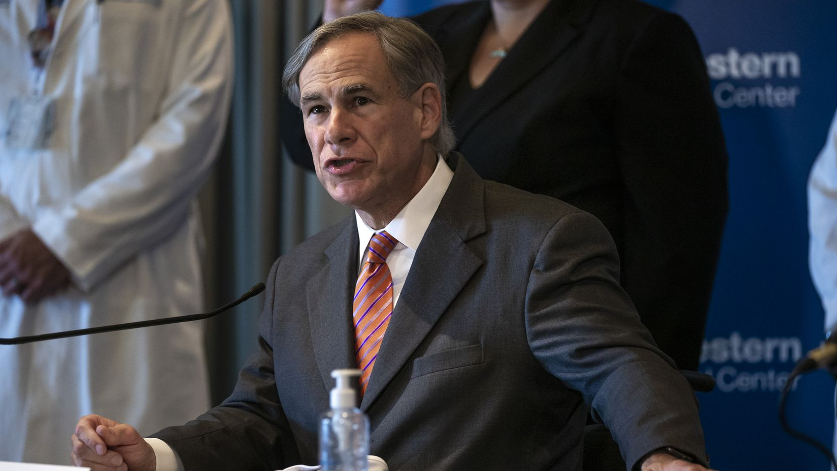 "Texas Governor Greg Abbott attended a news conference at the UT Southwestern Medical Center earlier this month. On Tuesday, he said: ""Cities that endanger residents by reducing law enforcement should not then be able to turn around and go back and get more property tax dollars from those same residents."""