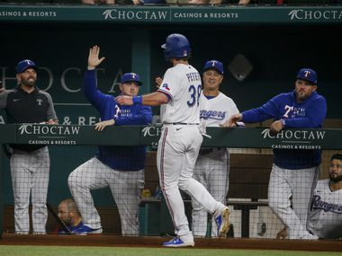Texas Rangers center fielder DJ Peters (38) celebrates after running to home following Texas Rangers first baseman Curtis Terry (83) singling to center against Los Angeles Angels on Tuesday, Aug. 3, 2021, at Globe Life Field in Arlington.