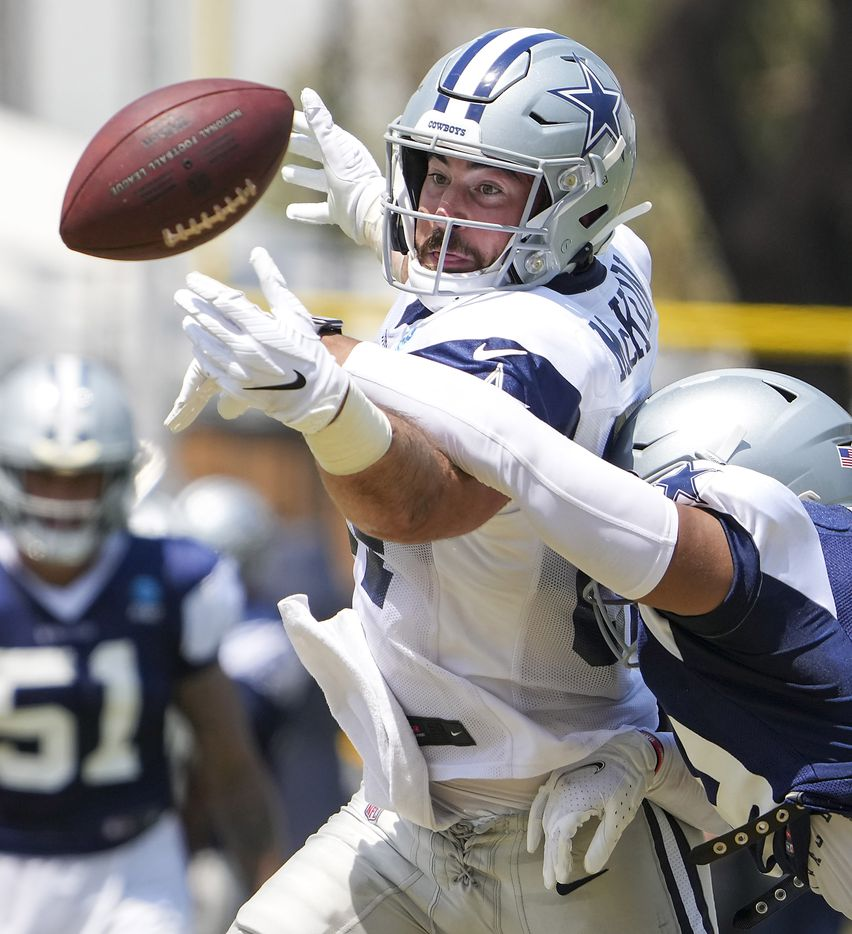 Dallas Cowboys tight end Sean McKeon (84) can't make a catch as safety Tyler Coyle (39) defends during a practice at training camp on Wednesday, July 28, 2021, in Oxnard, Calif.