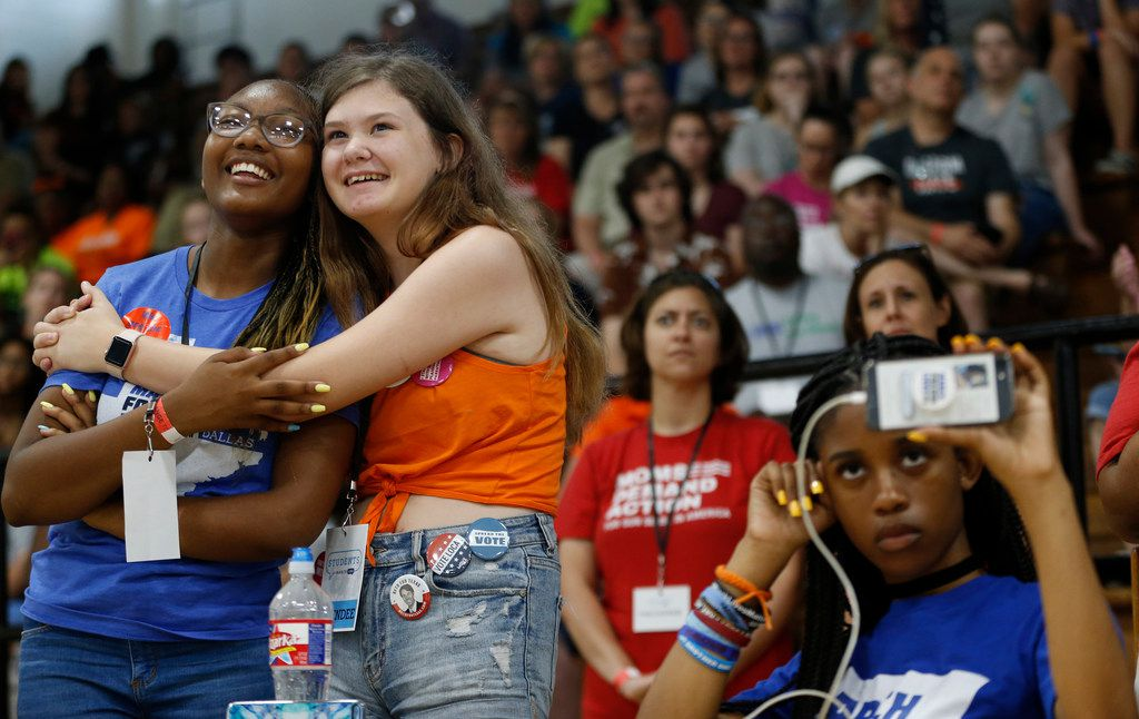 From left: Cera Perry-Johnson hugs Jacquelyn King as Kyrah Simon records a panel with students from Stoneman Douglas High School in Parkland, Fla., at Paul Quinn College in Dallas on July 7, 2018.