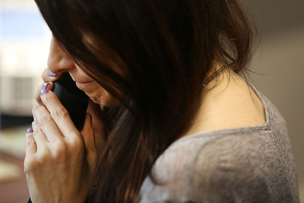 A call-taker speaks to someone at the Suicide and Crisis Center of North Texas offices in Dallas