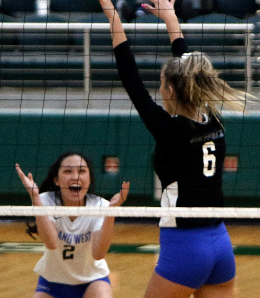 Lindsey Zhang (2) of Plano West, was all smiles after teammate Noelle Piatas (6) blocked the shot of a Prosper player during the first game of their match. The two teams played their District 9-6A volleyball match at Prosper High School in Prosper on October 22, 2019. (Steve Hamm/ Special Contributor)