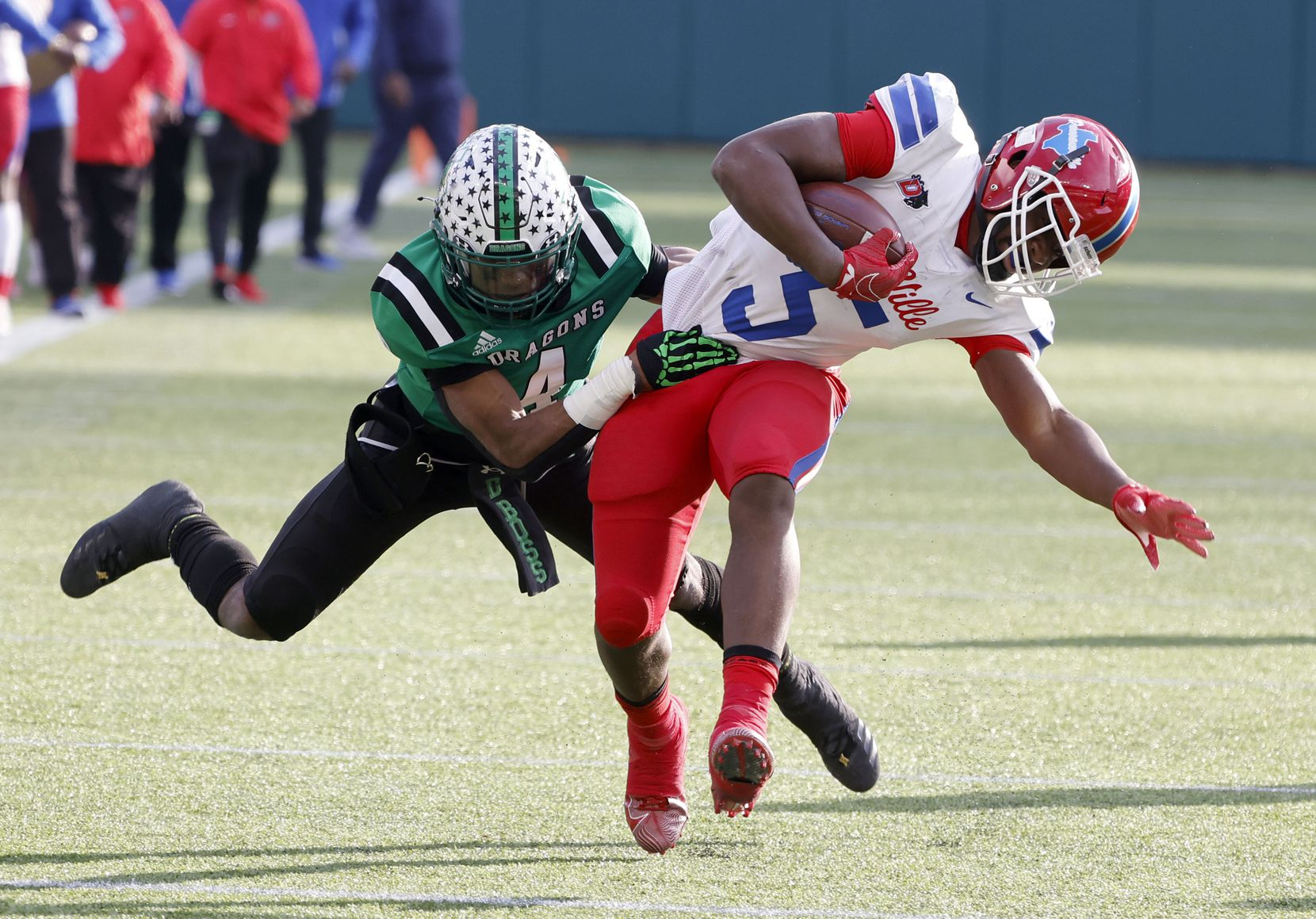 Southlake Carroll's Cinque Williams (4) tackles Duncanville's Malachi Medlock (5) during the Class 6A Division I state high school football semifinal in Arlington, Texas on Jan. 9, 2020. (Michael Ainsworth)