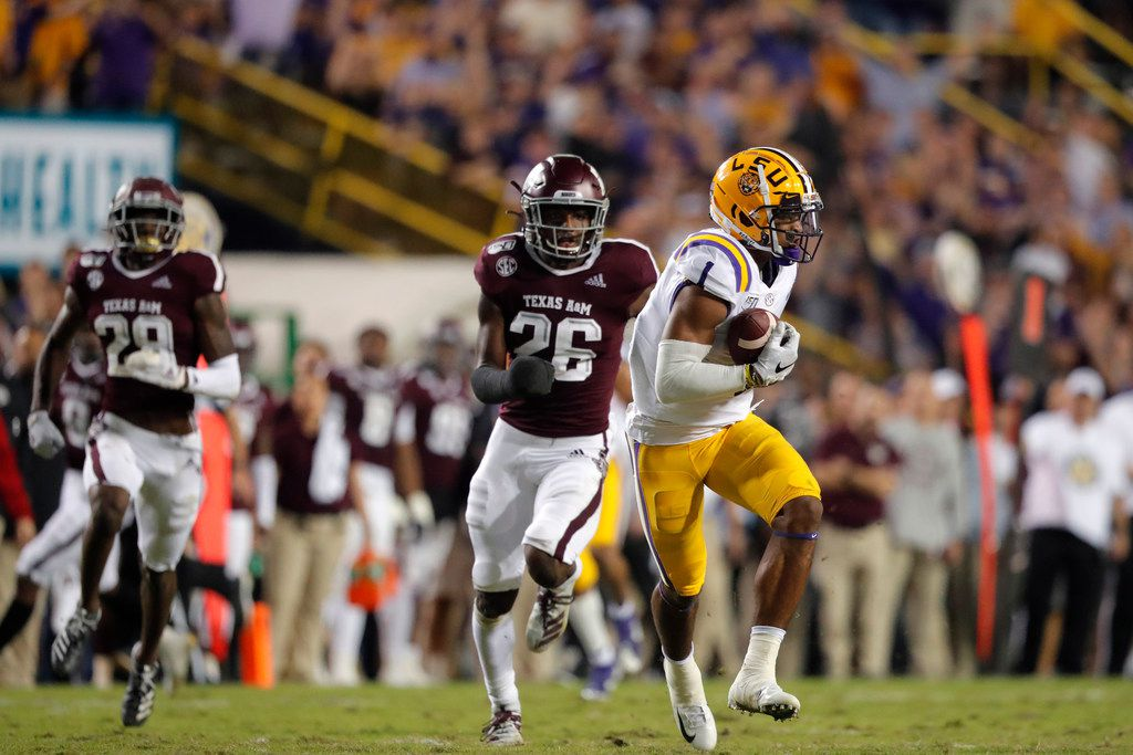 LSU wide receiver Ja'Marr Chase (1) pulls in a touchdown reception ahead of Texas A&M defensive back Demani Richardson (26) during the first half of an NCAA college football game in Baton Rouge, La., Saturday, Nov. 30, 2019. (AP Photo/Gerald Herbert)