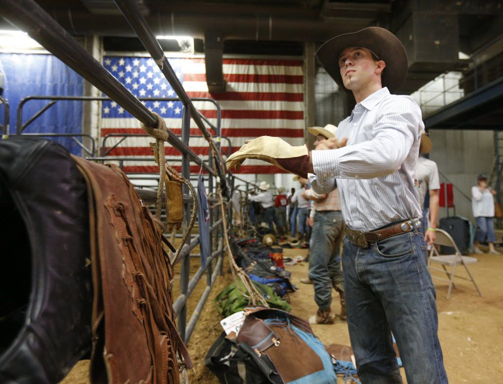 Bull rider McKennon Wimberly prepares his gear at the Mesquite Rodeo on June 6, 2014. (Michael Ainsworth/The Dallas Morning News)