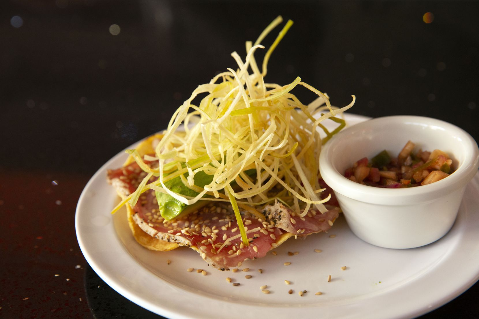 Caribbean's Shark Seafood features tuna with avocado, chipotle sauce on a tostada topped off with leeks.