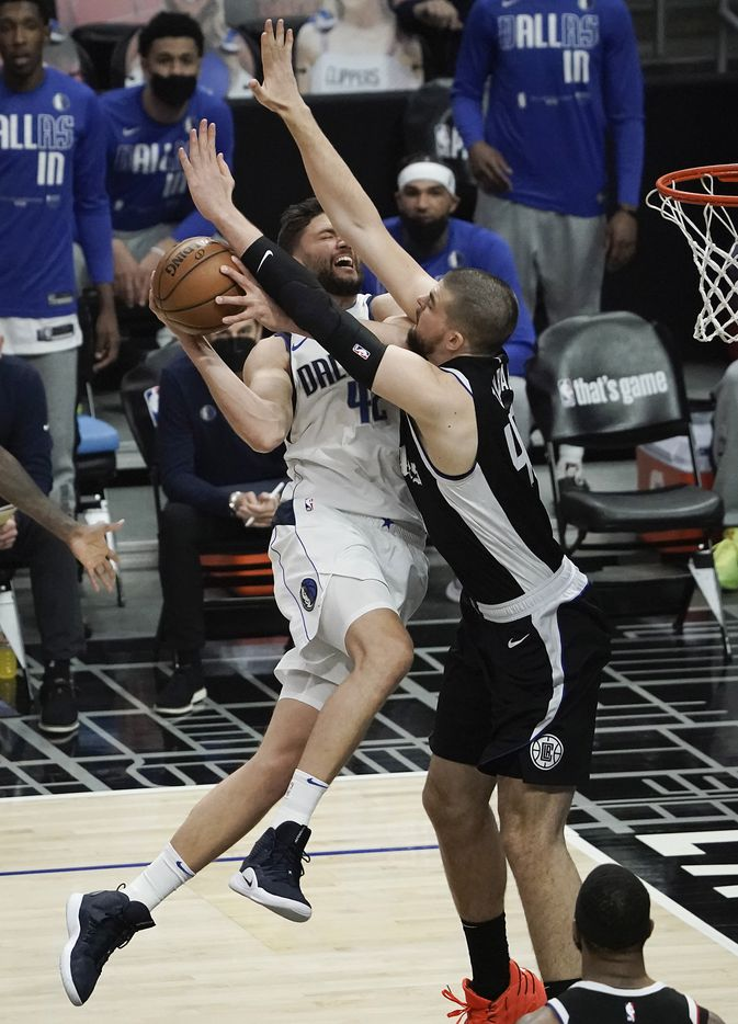 Dallas Mavericks forward Maxi Kleber (42) drives to the basket against LA Clippers center Ivica Zubac (40) during the first half of an NBA playoff basketball game at Staples Center on Saturday, May 22, 2021, in Los Angeles.