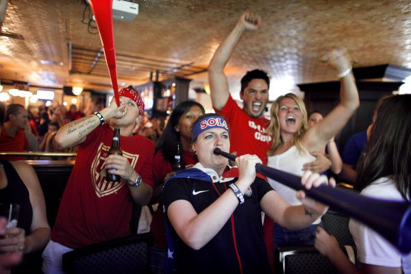 """In this DMN file photo, Rachel Patterson (left) and Tracy """"Ace"""" Leverenz blow their trumpets following the first U.S. goal during the 2011 Women's World Cup Finals match against Japan that was televised at Trinity Hall Irish Pub in Dallas."""