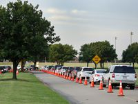 A line of drivers wait to have a nasal swab test in a drive-through COVID-19 testing site at Eastfield College in Mesquite on Monday.