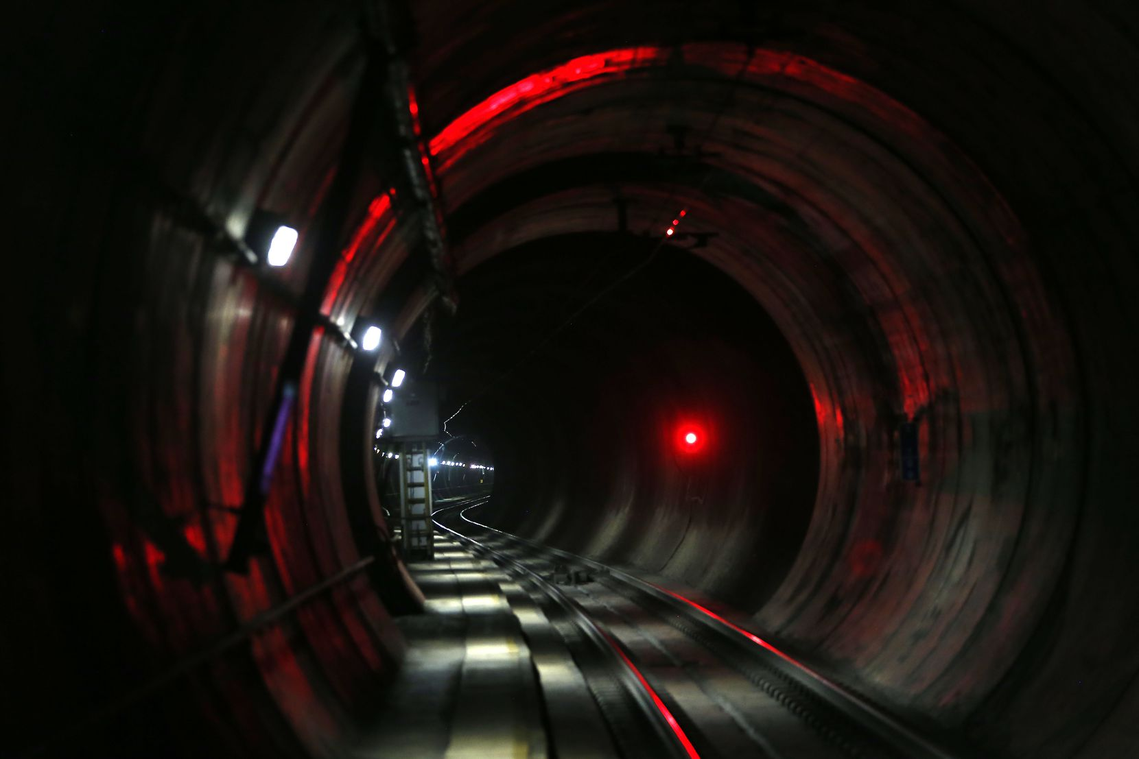 A red light signals the approach of a DART train in a tunnel 80 feet beneath the the Knox-Henderson area of Dallas. A planned underground station to serve the neighborhood was started but never completed after residents strongly objected.