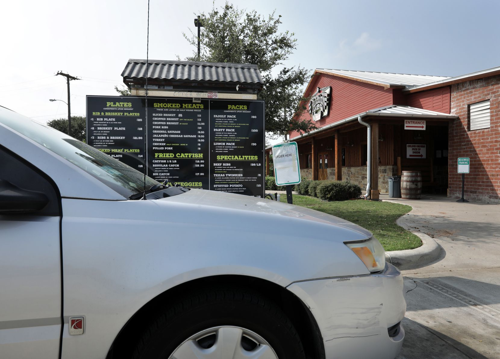 The drive-through lane gets busy at Hutchins BBQ in McKinney.