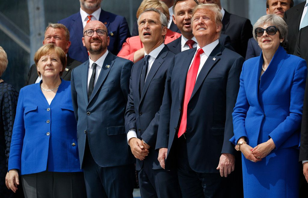 From left: German Chancellor Angela Merkel, Belgium's Prime Minister Charles Michel, NATO Secretary General Jens Stoltenberg, President Donald Trump and Britain's Prime Minister Theresa May look at the sky during a ceremonial fly-over ahead of the opening ceremony of the NATO summit in Brussels on Wednesday, July 11, 2018.