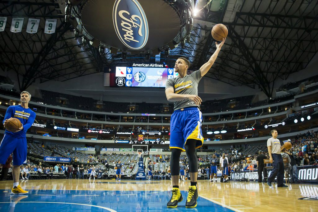 Golden State Warriors guard Stephen Curry warms up before an NBA basketball game against the Dallas Mavericks at American Airlines Center on Friday, March 18, 2016, in Dallas. (Smiley N. Pool/The Dallas Morning News)