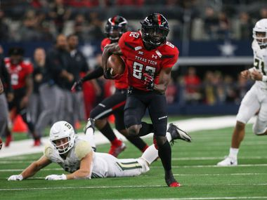 Texas Tech Red Raiders wide receiver KeSean Carter (82) breaks away for a run during the first half a matchup between Baylor and Texas Tech on Saturday, Nov. 24, 2018 at AT&T Stadium in Arlington, Texas.