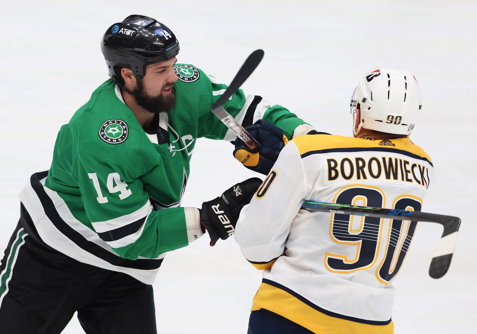 Dallas Stars left wing Jamie Benn (14) and Nashville Predators defenseman Mark Borowiecki (90) get tangled up during the first period of play in the Stars home opener at American Airlines Center on Friday, January 22, 2021in Dallas. (Vernon Bryant/The Dallas Morning News)