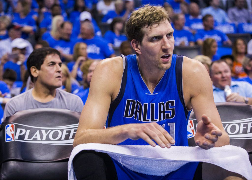Dallas Mavericks forward Dirk Nowitzki (41) watches from the bench during the second quarter of game 5 of their series in the first round of NBA playoffs on Monday, April 25, 2016 at Chesapeake Energy Arena in Oklahoma City, Oklahoma.  (Ashley Landis/The Dallas Morning News)