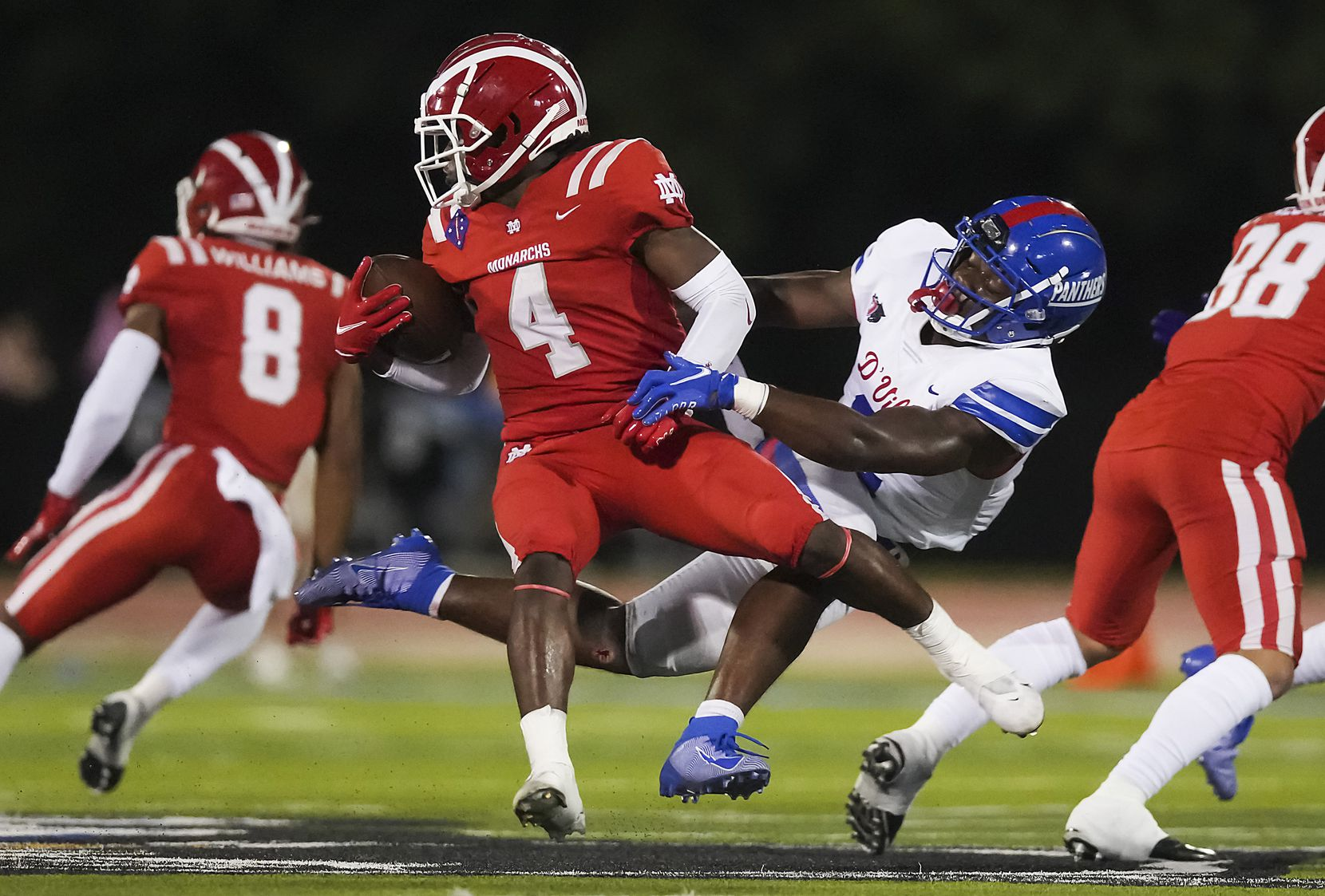 Mater Dei running back Raleek Brown (4) is brought down by Duncanville linebacker Jordan Crook (2) during the first half of a high school football game on Friday, Aug. 27, 2021, in Duncanville. (Smiley N. Pool/The Dallas Morning News)