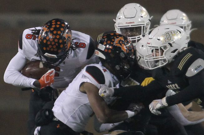 Aledo running back Demarco Roberts (6) puts his head down and bulls his way for a rushing first down with the help of receiver JoJo Earle that effectively blocked multiple Wichita Falls Riders defenders during first half action. The two teams played their Class 5A Division ll state semifinal football playoff game at Apogee Stadium in Denton on January 8, 2021. (Steve Hamm/ Special Contributor)