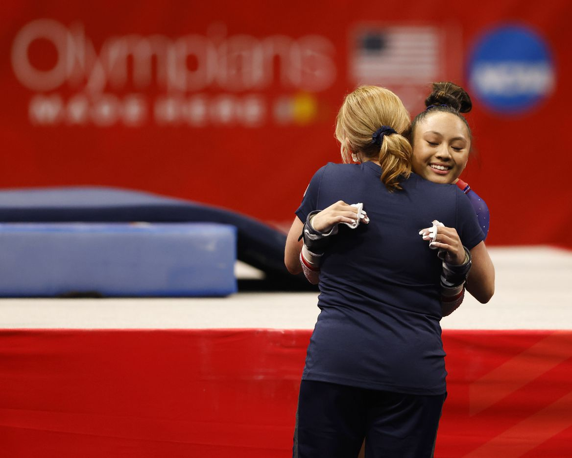 Emma Malabuyo of Texas Dreams hugs her coach Kim Zmeskal after competing in the uneven bars during day 1 of the women's 2021 U.S. Olympic Trials at America's Center on Friday, June 25, 2021 in St Louis, Missouri.(Vernon Bryant/The Dallas Morning News)