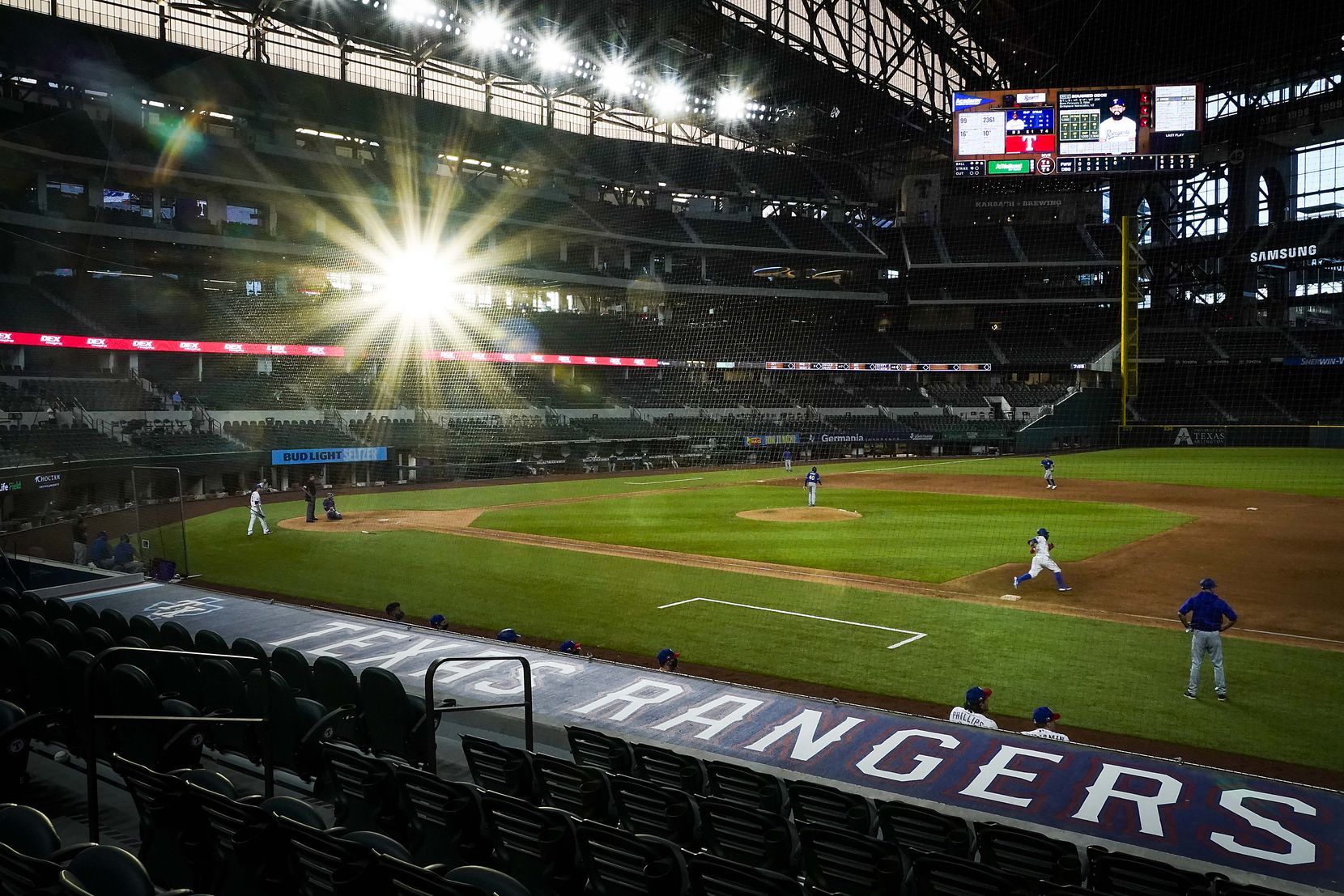 Rougned Odor rounds first base as sunlight streams in the stadium during a Texas Rangers Summer Camp intrasquad game at Globe Life Field on Saturday, July 18, 2020.