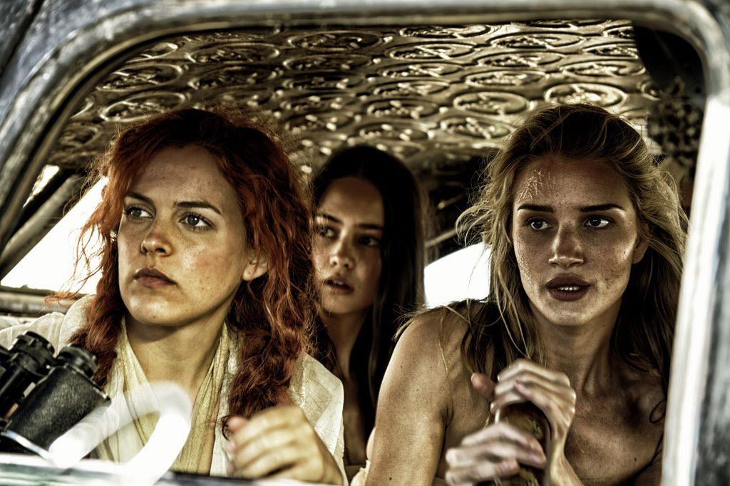 """From left: Riley Keough as Capable, Courtney Eaton as Cheedo the Fragile, and Rosie Huntington-Whiteley as The Splendid Angharad, in Warner Bros. Pictures' and Village Roadshow Pictures' action adventure film, """"Mad Max: Fury Road,"""" a Warner Bros. Pictures release."""