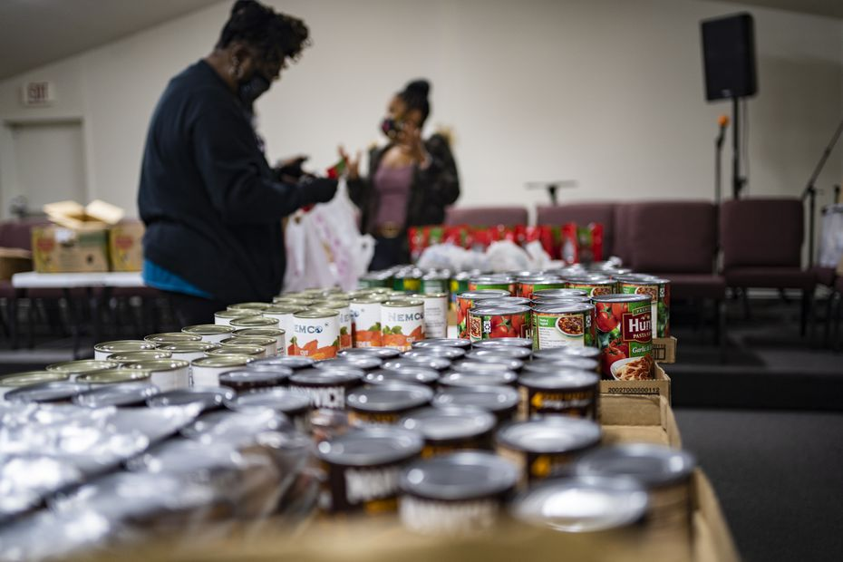 Ms. Paula Johnson  (left) and April Parker (right) seen here working on food distribution packages for local community residents at the Cities of Refuge Church