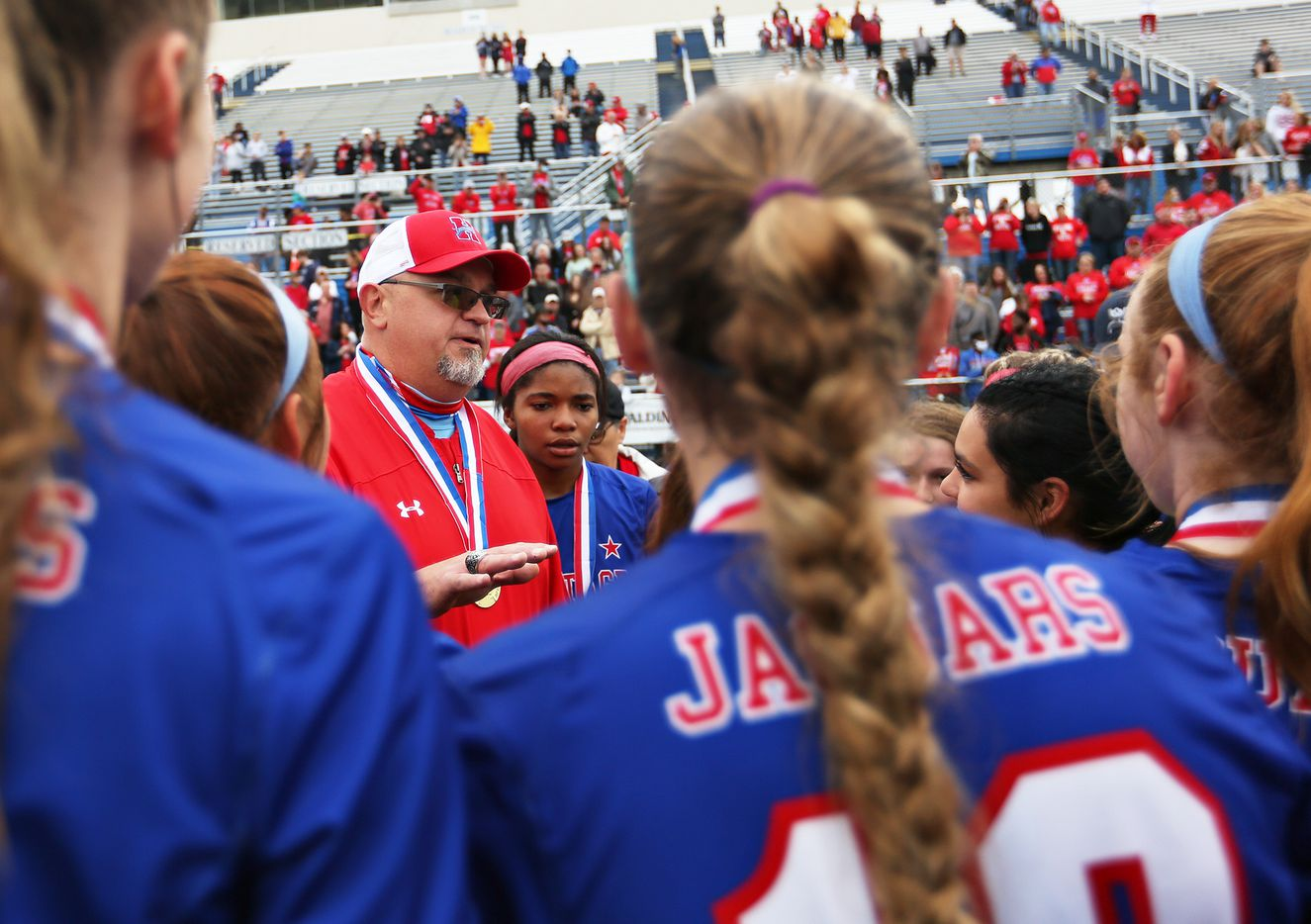 Midlothian Heritage head coach Gerald Slovacek chats with his players at their win over Calallen at their UIL 4A girls State championship soccer game at Birkelbach Field on April 16, 2021 in Georgetown, Texas.  (Thao Nguyen/Special Contributor)