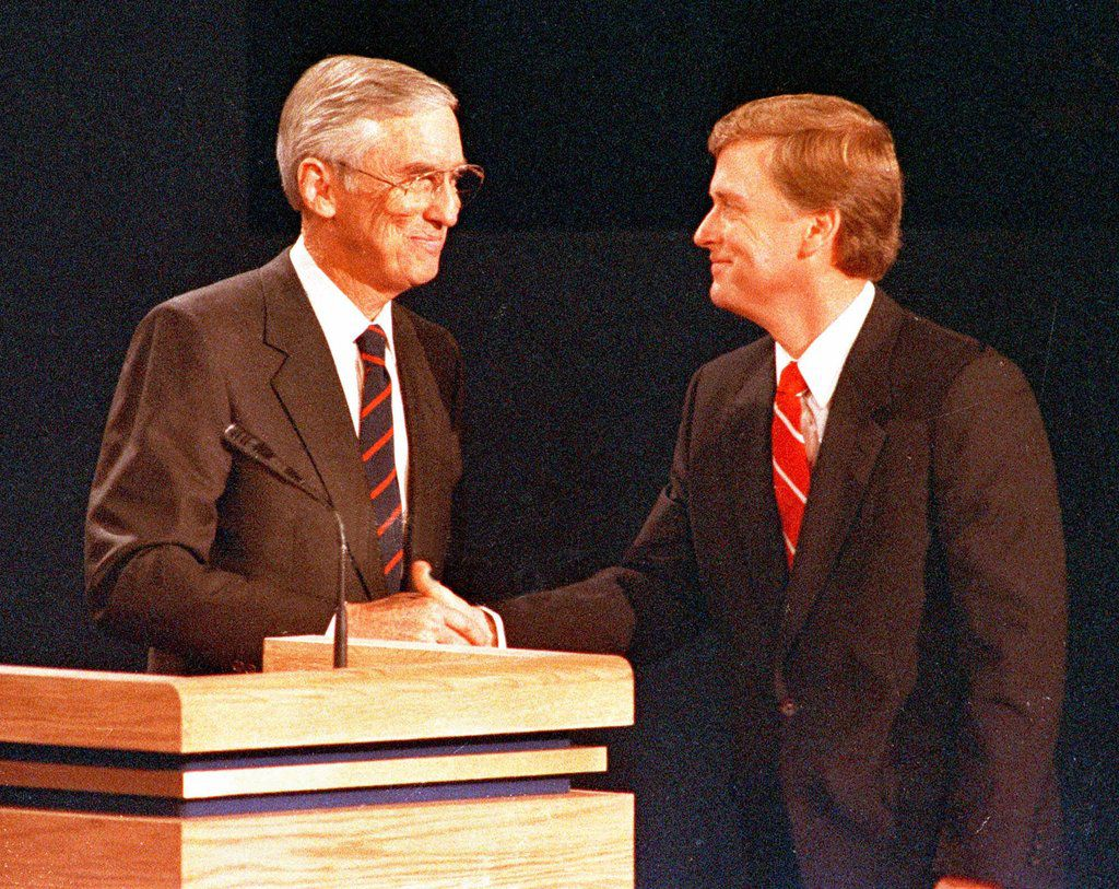 Sen. Lloyd Bentsen (left) and Sen. Dan Quayle shake hands Oct. 6, 1988, after their vice presidential debate in Omaha, Neb.