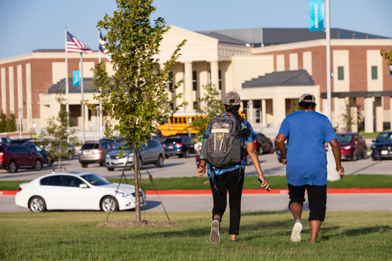 A mother walked her daughter to class at Rock Hill High School in Frisco on Wednesday for her first day back amid the pandemic. Prosper ISD is one of three that opened its doors for students Wednesday.