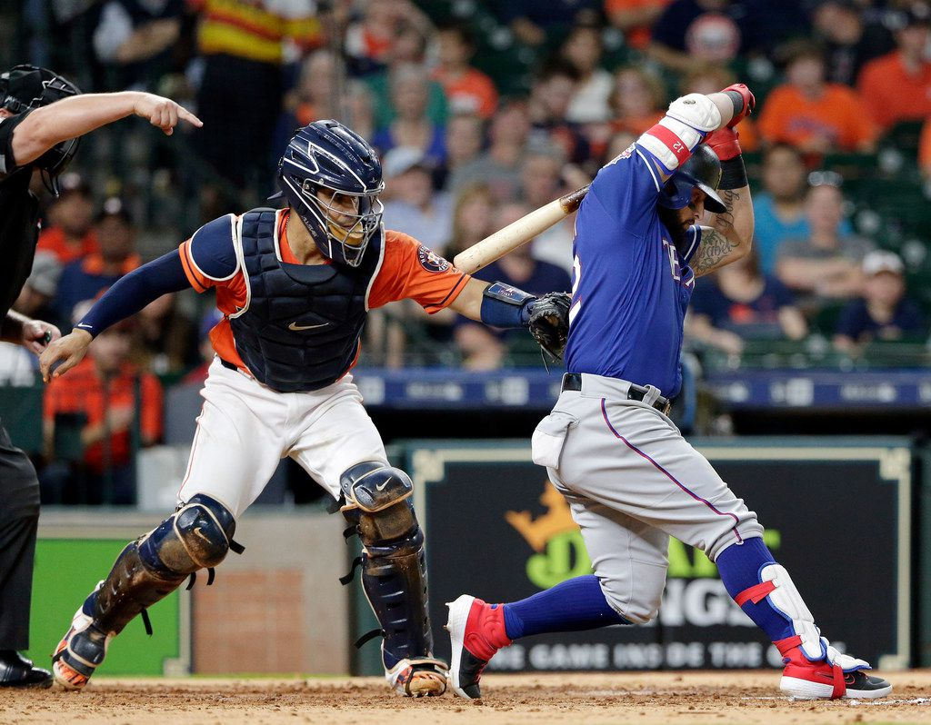 Houston Astros catcher Robinson Chirinos, left, tags Texas Rangers Rougned Odor, right, after his swing for the out to end the top of the seventh inning of a baseball game Friday, May 10, 2019, in Houston. (AP Photo/Michael Wyke)