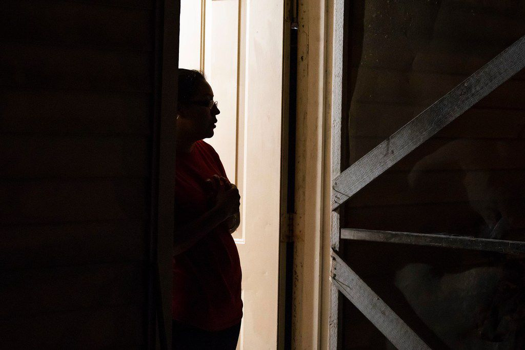 Lili, a Guatemalan immigrant, stands in the doorway of her home on Wednesday, Feb. 6, 2019, in Dallas.