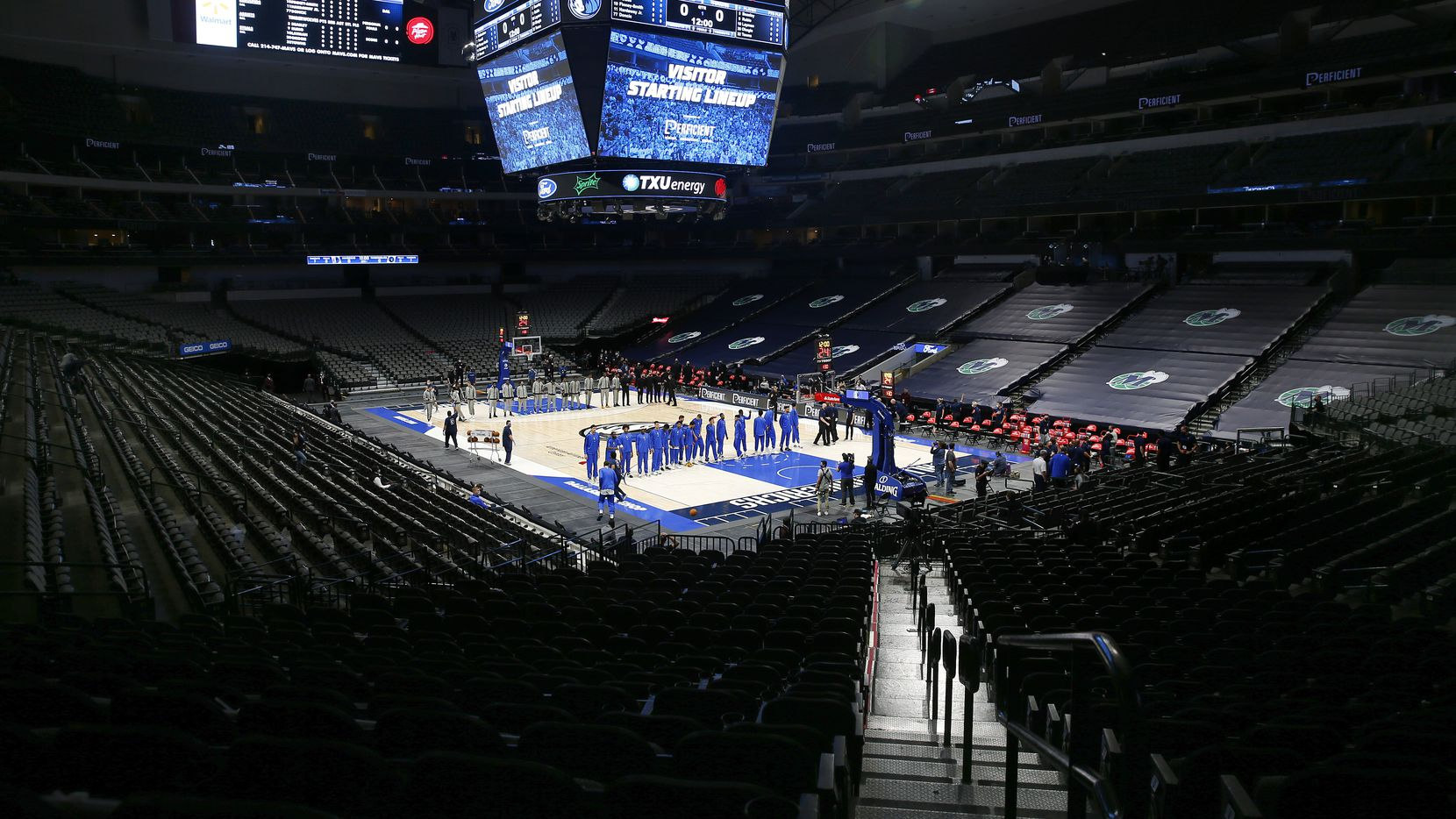 Before the empty stands of American Airlines Center, the Dallas Mavericks and Minnesota Timberwolves line up for the national anthem on Thursday, Dec. 17, 2020. The players were confused because the national anthem wasn't played before their preseason game.