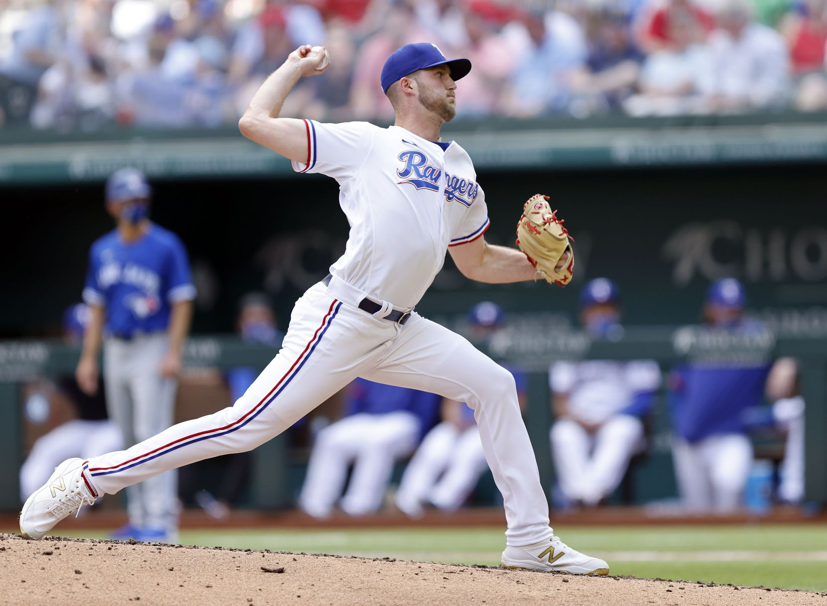 Texas Rangers starting pitcher Kyle Cody (54) throws against the Toronto Blue Jays in the fifth inning at Globe Life Field in Arlington, Monday, April 5, 2021. The Texas Rangers were facing the Toronto Blue Jays in their home opener. (Tom Fox/The Dallas Morning News)