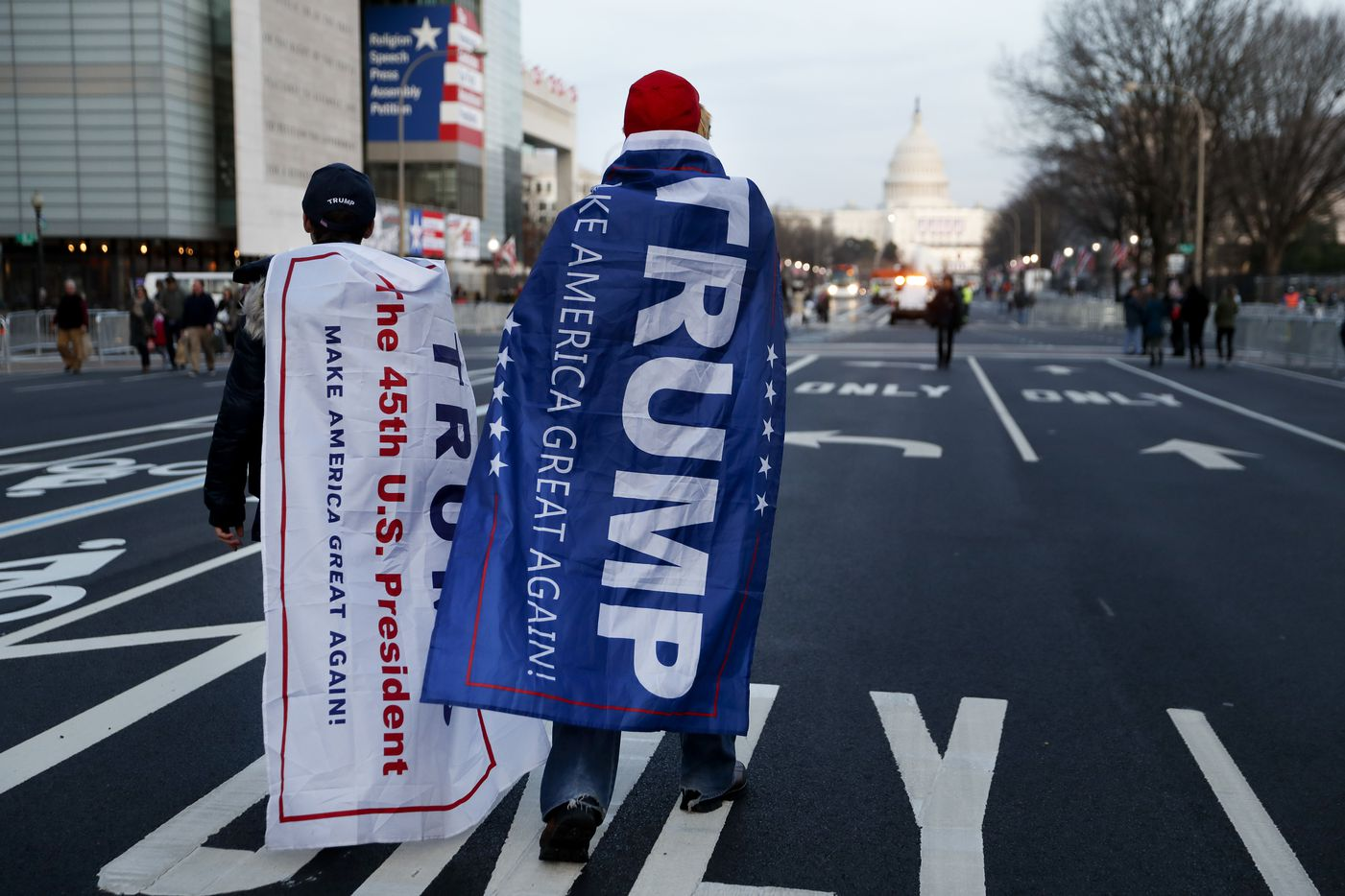 Supporters of President-elect Donald Trump walk along Pennsylvania Avenue after it was closed down to thru-traffic as security tightens ahead of the presidential inauguration, Thursday, Jan. 19, 2017, in Washington.