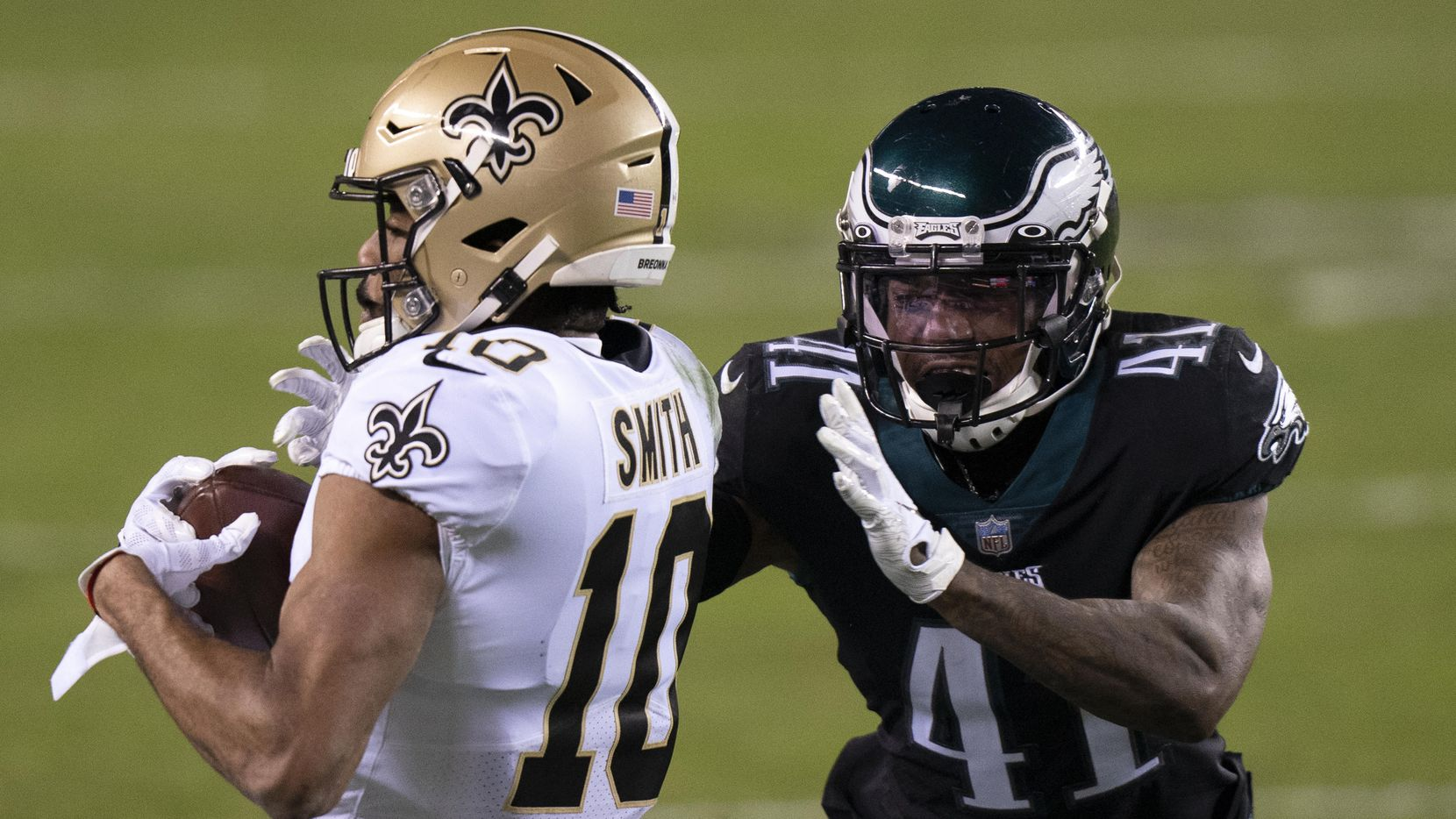 New Orleans Saints wide receiver Tre'Quan Smith (10) catches the ball with Philadelphia Eagles cornerback Kevon Seymour (41) defending during the NFL football game, Sunday, Dec. 13, 2020, in Philadelphia.