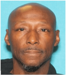 Gregory Thomas is described as a bald man with brown eyes who is 6 feet tall and about 140 pounds.
