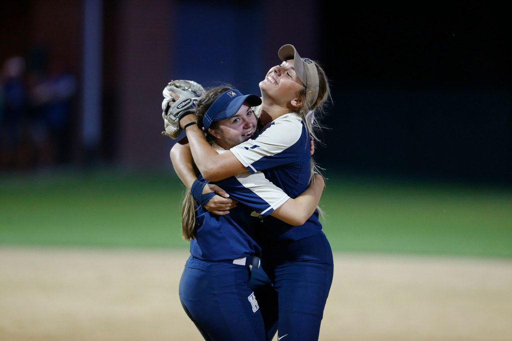 Keller's Bella Oboyski (2left) ) and Amanda Desario (4) embrace after Desario caught a fly ball to end the inning against Plano at Tina Minke Field in Denton, Texas on May 25, 2018. (Nathan Hunsinger/The Dallas Morning News)