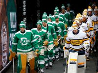 Dallas Stars and Nashville Predators players walk in single file line for warmups before their outdoor NHL Winter Classic hockey game at the Cotton Bowl in Dallas, Wednesday, January 1, 2019.