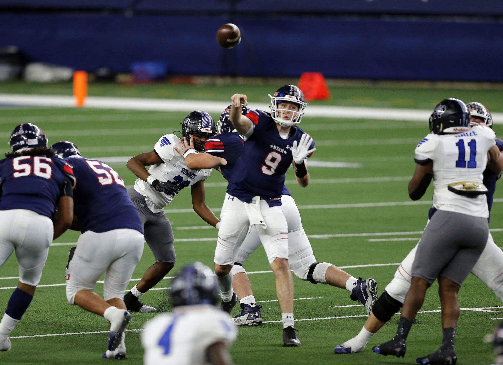 Denton Ryan QB Seth Henigan (9) gets good blocking, as he throws a pass during the first half of the Class 5A Division I state semifinal football playoff game against Mansfield Summit High at AT&T Stadium in Arlington on Friday, January 8, 2021. (John F. Rhodes / Special Contributor)