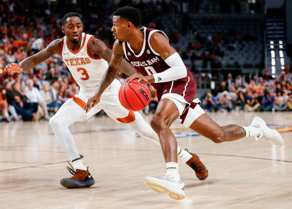 Texas A&M Aggies guard Jay Jay Chandler (0) drives past Texas Longhorns guard Courtney Ramey (3) during the second half of a basketball matchup between the Texas Longhorns and Texas A&M Aggies in the Lone Star Showdown on Sunday, Dec. 8, 2019 at Dickies Arena in Fort Worth, Texas.