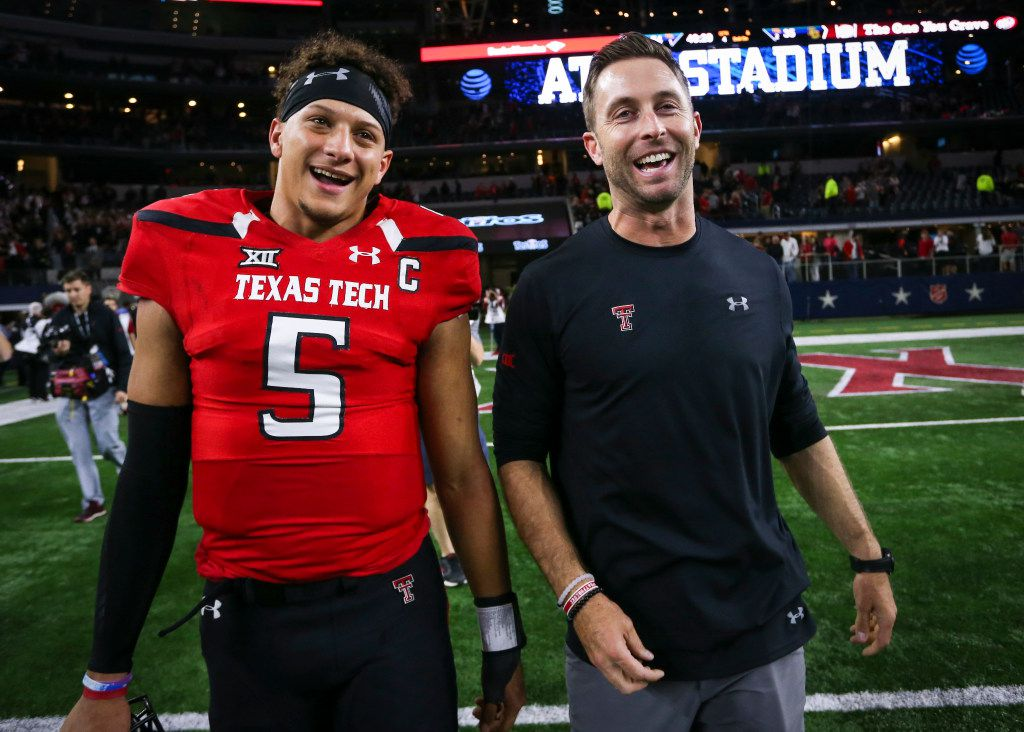 Texas Tech quarterback Patrick Mahomes II (5) and head coach Kliff Kingsbury walk off the field after after a 54-35 win against Baylor at AT&T Stadium in Arlington, Texas, on Friday, Nov. 25, 2016. (Richard W. Rodriguez/Fort Worth Star-Telegram/TNS)