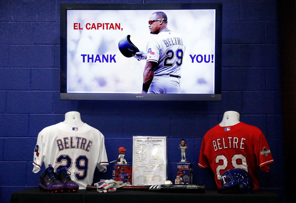 A collection of memorabilia is set before former Texas Rangers third baseman Adrian Beltre's retirement press conference at Globe Life Park in Arlington, Texas, Friday, November 30, 2018. Beltre played 21 seasons (1998-2018) in the Major Leagues, the last eight with the Rangers (2011-18). (Tom Fox/The Dallas Morning News)